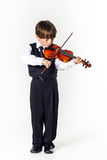 Red-haired preschooler boy with violin Stock Photos