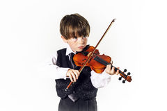 Red-haired preschooler boy with violin Royalty Free Stock Photos