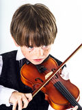 Red-haired preschooler boy with violin Royalty Free Stock Photography
