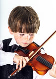 Red-haired preschooler boy with violin Stock Image