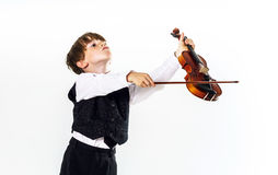 Red-haired preschooler boy with violin Stock Images