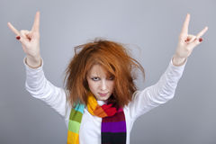 Red-haired rock girl in scarf. Royalty Free Stock Image