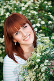 Red-haired smiling woman Stock Photo