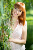 Red-haired smiling woman Royalty Free Stock Photos