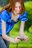 Red-haired smiling young woman photographed Royalty Free Stock Photos
