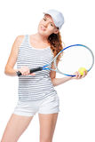 Red-haired sportswoman in a cap with a tennis racket. Posing Stock Photos