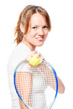 Red-haired sportswoman with racket and ball for tennis on white. Background Royalty Free Stock Image