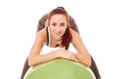 Red-haired sporty girl posing with fitness ball Royalty Free Stock Image