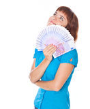 Red-haired teen-girl with money in hand stock photos