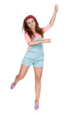 Red-haired teen girl in shorts. Stock Photos