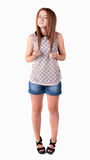 Red-haired teen girl in shorts. Royalty Free Stock Images