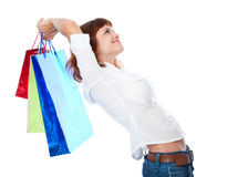 Red-haired teen-girl with three shopping bag Royalty Free Stock Photos