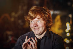 Red-haired teenage boy with crafty plans. Emotions Stock Photography