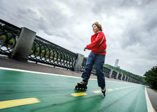 Red-haired teenage boy rollerskating Royalty Free Stock Image