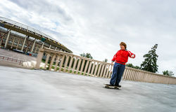 Red-haired teenage boy rollerskating Royalty Free Stock Photography
