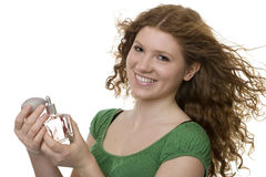 Red haired teenager with perfume Royalty Free Stock Photos