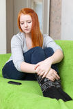 Red-haired  teenager waits telephone call Royalty Free Stock Image