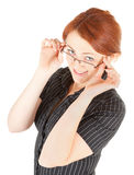 Red-haired trendy girl. Portrait of red haired girl with glasses Stock Photo