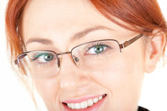 Red-haired trendy girl. Portrait of red haired girl with glasses. Focus on glasses Royalty Free Stock Image
