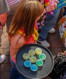 A Red haired waitress carries tray of jellow shots - top view Kansas City MO USA May 5 2011 stock images