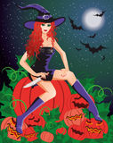 Red-haired witch with a knife Stock Photography