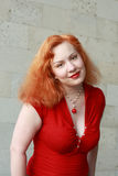 Red-haired woman Stock Images