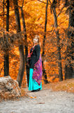 Red-haired woman in the autumn Stock Images