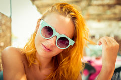 Red haired woman in beach cafe Royalty Free Stock Image