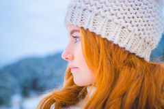 Red haired woman with beanie