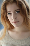 Red Haired Woman in Beige Dress Royalty Free Stock Image