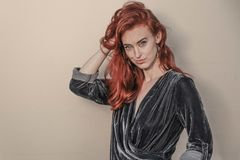 Red Haired Woman in Black Long-sleeved Top Stock Photo
