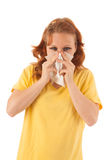 Red haired woman blowing nose Stock Images