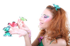 Red-haired woman with butterflies Royalty Free Stock Image