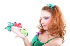 Red-haired woman with butterflies Stock Photography