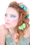 Red-haired woman with butterflies on her head Stock Images