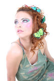 Red-haired woman with butterflies on her head Royalty Free Stock Photo