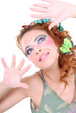 Red-haired woman with butterflies on her head Stock Photos
