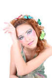 Red-haired woman with butterflies on her head Royalty Free Stock Images