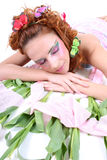 Red-haired woman with butterflies lying Stock Photos