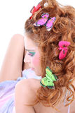 Red-haired woman with butterflies lying Royalty Free Stock Images