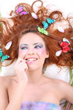 Red-haired woman with butterflies lying Royalty Free Stock Photos