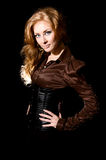 Red-haired woman in corset Stock Image