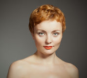 Red haired  woman  with  curly haircut Royalty Free Stock Photography