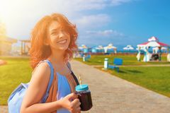 Woman in dress drinking smoothies stock photography