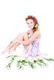 Red-haired woman in dress with flowers Royalty Free Stock Image