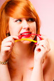 Red haired woman eat sweets. Royalty Free Stock Photography