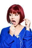 Red-haired woman expression - hello to headphones Royalty Free Stock Image
