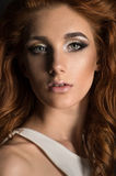 Red haired woman with expressive makeup Stock Photo