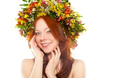Red haired woman with flower wreath on head Stock Photo