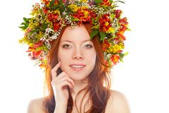 Red haired woman with flower wreath on head Stock Image